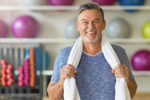 a man holding a towel after a workout