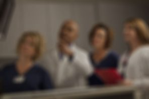 blurred photo of doctors and nurses