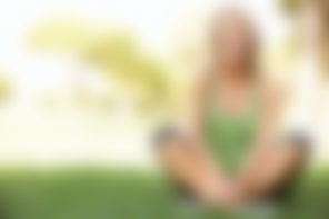 blurred version of a woman sitting in a park